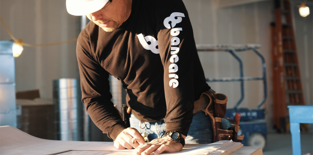 Bancare construction worker with plans
